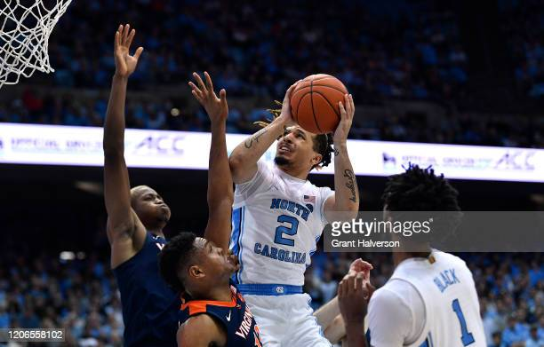 Cole Anthony of the North Carolina Tar Heels drives against Casey Morsell of the Virginia Cavaliers during the second half of their game at the Dean...