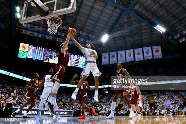 Cole Anthony of the North Carolina Tar Heels shoots against Federico Poser of the Elon Phoenix during the second half of their game at the Dean Smith...
