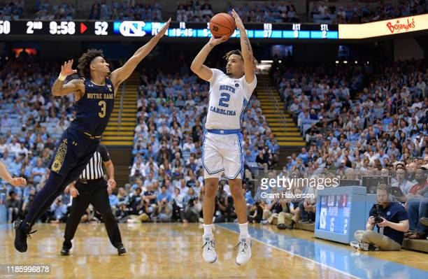 Cole Anthony of the North Carolina Tar Heels shoots over Prentiss Hubb of the Notre Dame Fighting Irish during the second half at the Dean Smith...