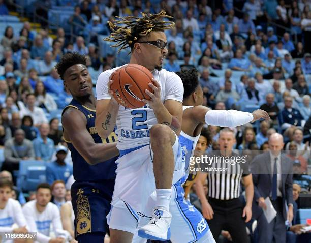 Cole Anthony of the North Carolina Tar Heels takes a rebound away from TJ Gibbs of the Notre Dame Fighting Irish during the first half at the Dean...