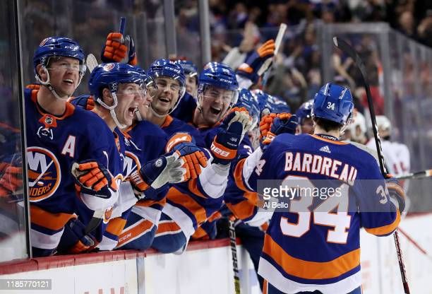 Cole Bardreau of the New York Islanders celebrates scoring his first NHL goal in the second period against Craig Anderson of the Ottawa Senators...