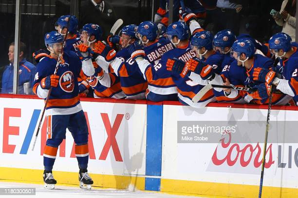 Cole Bardreau of the New York Islanders celebrates with the bench after scoring his first NHL goal past Craig Anderson of the Ottawa Senators on a...