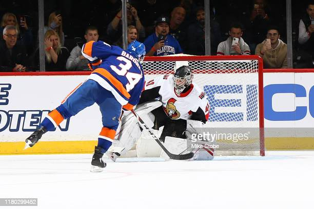 Cole Bardreau of the New York Islanders scores his first NHL goal past Craig Anderson of the Ottawa Senators om a penalty shot in the second period...