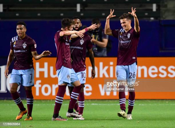 Cole Bassett is congratulated by Jonathan Lewis Sam Vines and Kellyn Acosta of Colorado Rapids after scoring a goal in the first half of the game at...