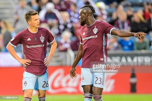 Cole Bassett of the Colorado Rapids speaks with teammate Kei Kamara the first half at Dick's Sporting Goods Park on June 8 2019 in Commerce City...