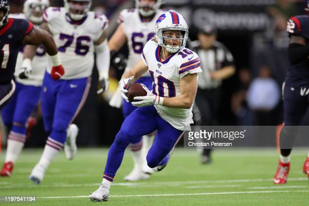 Cole Beasley of the Buffalo Bills carries the ball against the Houston Texans during the second quarter of the AFC Wild Card Playoff game at NRG...