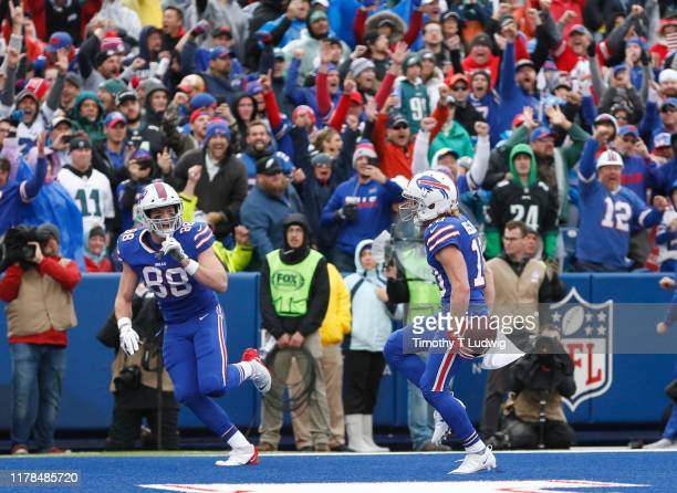 Cole Beasley of the Buffalo Bills celebrates his touchdown during the first half with Dawson Knox against the Philadelphia Eagles at New Era Field on...