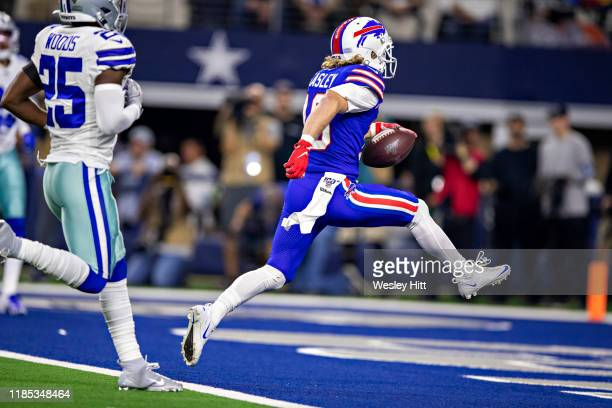 Cole Beasley of the Buffalo Bills runs a pass in for a touchdown in the second quarter on Thanksgiving Day during a game against the Dallas Cowboys...