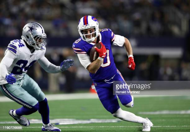 Cole Beasley of the Buffalo Bills runs the ball against Chidobe Awuzie of the Dallas Cowboys in the second half at ATT Stadium on November 28 2019 in...