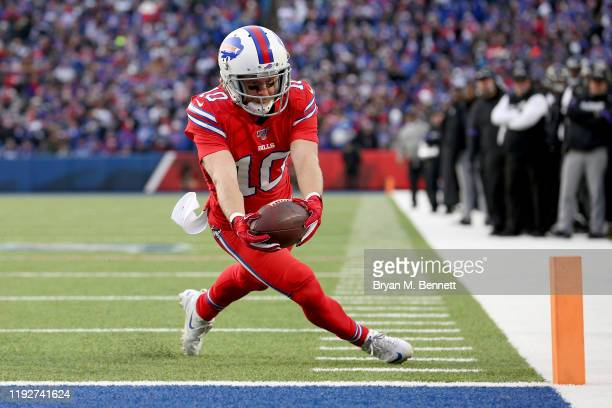 Cole Beasley of the Buffalo Bills scores a touchdown during the fourth quarter of an NFL game against the Baltimore Ravens at New Era Field on...