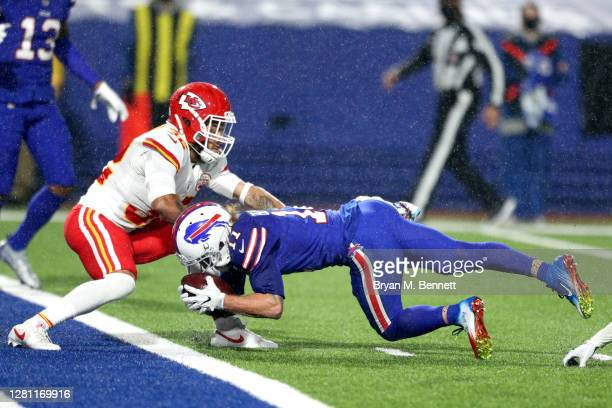 Cole Beasley of the Buffalo Bills scores an eight-yard touchdown reception past Tyrann Mathieu of the Kansas City Chiefs during the second half at...