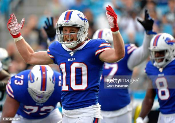 Cole Beasley of the Buffalo Bills signals for a touchdown by teammate LeSean McCoy during the first quarter of their preseason game against the...