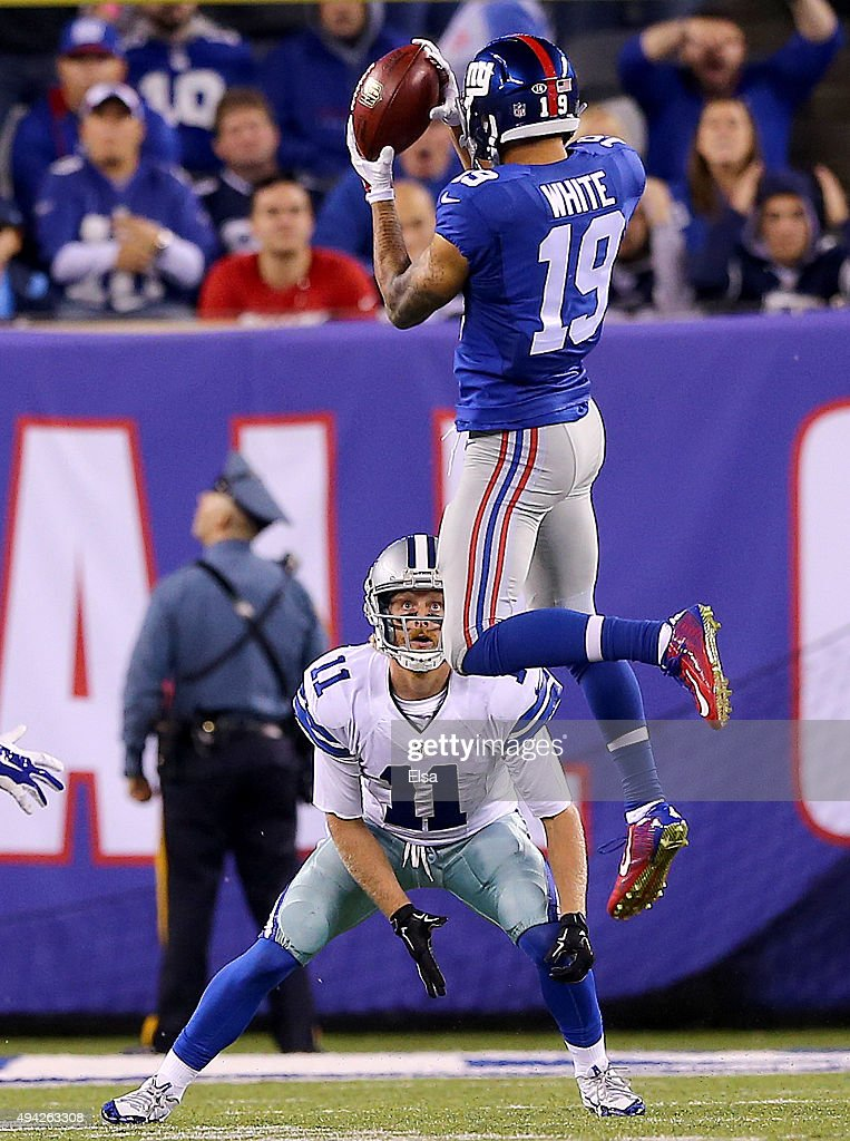 Cole Beasley #11 of the Dallas Cowboys bobbles the punt and is recovered by Myles White #19 of the New York Giants in the fourth quarter at MetLife Stadium on October 25, 2015 in East Rutherford, New Jersey.