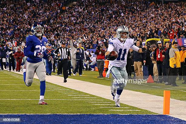 Cole Beasley of the Dallas Cowboys carries a reception in for a 45 yard touchdown in the third quarter against the New York Giants at MetLife Stadium...