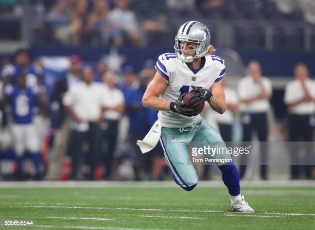 Cole Beasley of the Dallas Cowboys carries the ball against the Indianapolis Colts in the first half of a preseason game at ATT Stadium on August 19...