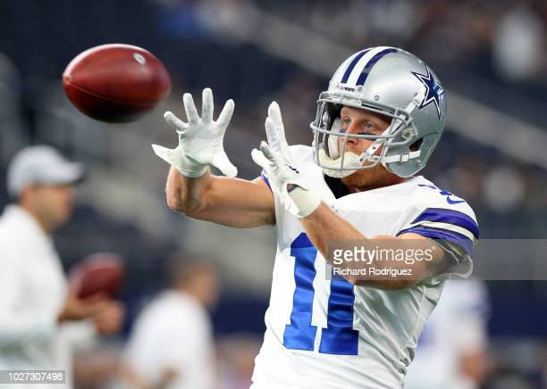 Cole Beasley of the Dallas Cowboys catches a pass in warmups before the preseason football game against the Arizona Cardinals at ATT Stadium on...