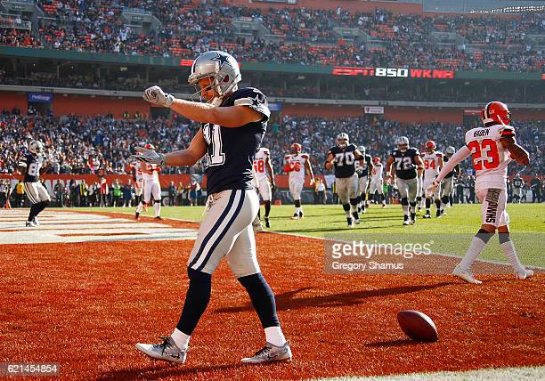 Cole Beasley of the Dallas Cowboys celebrates his 6 yard touchdown catch in the first half against the Cleveland Browns at FirstEnergy Stadium on...