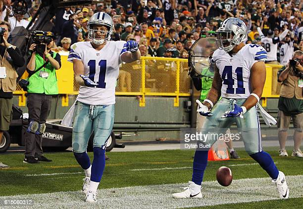 Cole Beasley of the Dallas Cowboys celebrates his touchdown with teammate Keith Smith against the Green Bay Packers during the fourth quarter at...