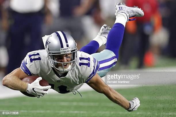 Cole Beasley of the Dallas Cowboys dives for extra yards in the second quarter against the Chicago Bears at ATT Stadium on September 25 2016 in...