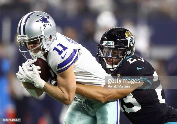 Cole Beasley of the Dallas Cowboys gets tackled by Tyler Patmon of the Jacksonville Jaguars in the second quarter of a game at ATT Stadium on October...