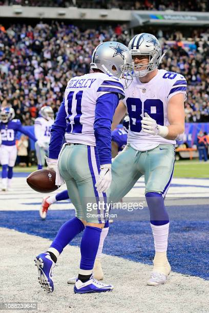 Cole Beasley of the Dallas Cowboys is congratulated by his teammate Blake Jarwin after his fourth quarter touchdown against the New York Giants at...