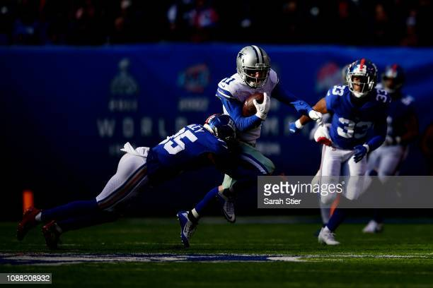 Cole Beasley of the Dallas Cowboys is tackled by Curtis Riley of the New York Giants during the second quarter of the game at MetLife Stadium on...