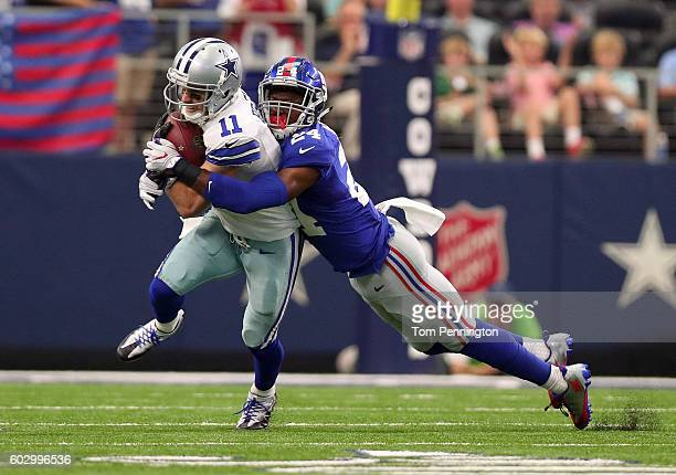 Cole Beasley of the Dallas Cowboys is tackled by Eli Apple of the New York Giants after catching a pass at ATT Stadium on September 11 2016 in...