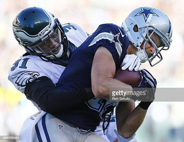 Cole Beasley of the Dallas Cowboys makes a catch as he is tackled by Byron Maxwell of the Philadelphia Eagles during the first quarter of a football...