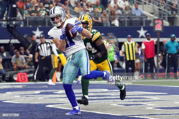 Cole Beasley of the Dallas Cowboys pulls in a touchdown pass ahead of Quinten Rollins of the Green Bay Packers in the second quarter of a football...