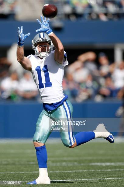 Cole Beasley of the Dallas Cowboys reaches for a catch in the second quarter against the Seattle Seahawks during their game at CenturyLink Field on...