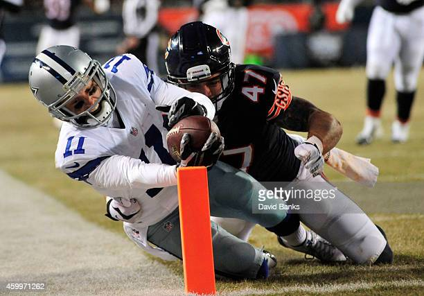 Cole Beasley of the Dallas Cowboys reaches for the end zone to score as Chris Conte of the Chicago Bears defends during the third quarter of a game...