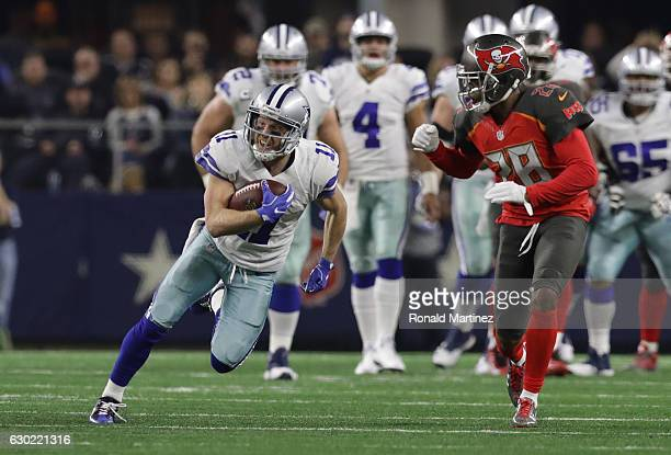 Cole Beasley of the Dallas Cowboys runs after catching a pass during the first quarter against the Tampa Bay Buccaneers at ATT Stadium on December 18...