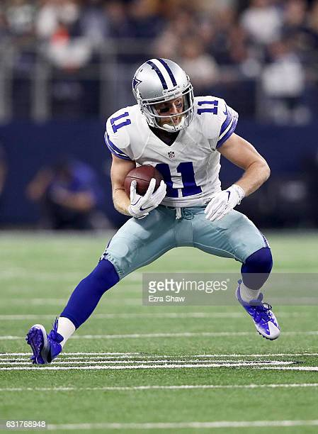 Cole Beasley of the Dallas Cowboys runs with the ball in the first half during the NFC Divisional Playoff Game against the Green Bay Packers at ATT...