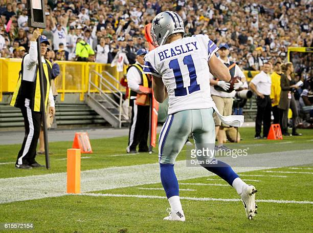Cole Beasley of the Dallas Cowboys scores a touchdown in the fourth quarter against the Green Bay Packers at Lambeau Field on October 16 2016 in...