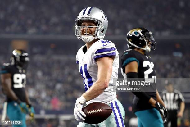 Cole Beasley of the Dallas Cowboys smiles after scoring a touchdown in the second quarter against the Jacksonville Jaguars at ATT Stadium on October...