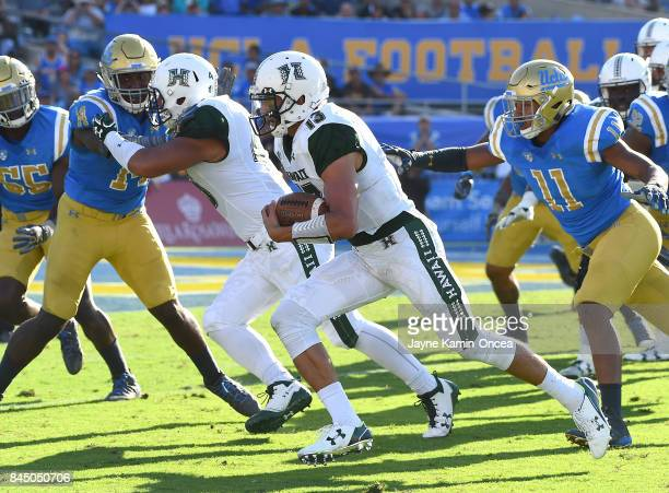 Cole Brownholtz of the Hawaii Warriors gets pas Keisean Lucier-South of the UCLA Bruins as he runs for a touch down in the fourth quarter of the game...