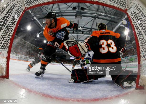 Cole Cassels of Wolfsburg struggels in front of the net during the DEL match between Grizzlys Wolfsburg and Straubing Tigers at Eisarena Wolfsburg on...