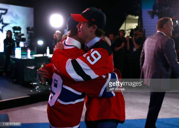 Cole Caufield , fifteenth overall pick of the Montreal Canadiens, and Jack Hughes, first overall pick of the New Jersey Devils, congratulate one...
