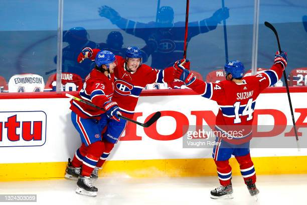 Cole Caufield of the Montreal Canadiens is congratulated by Tyler Toffoli and Nick Suzuki after scoring a goal against the Vegas Golden Knights...
