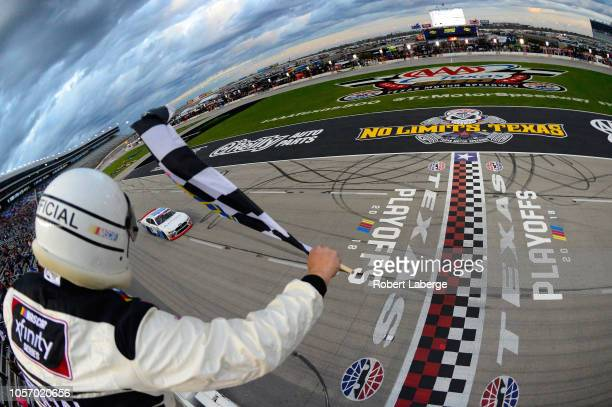 Cole Custer driver of the Autodesk Ford crosses the finish line to win the NASCAR Xfinity Series O'Reilly Auto Parts 300 at Texas Motor Speedway on...