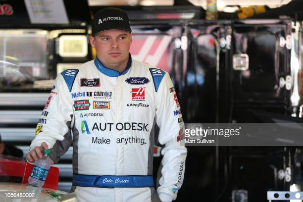 Cole Custer driver of the Autodesk Ford stands in the garage during practice for the NASCAR Xfinity Series O'Reilly Auto Parts 300 at Texas Motor...