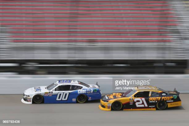 Cole Custer driver of the Code 3 Associates Ford leads Daniel Hemric driver of the South Point Hotel Casino Chevrolet during practice for the NASCAR...