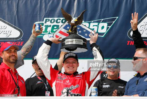 Cole Custer driver of the FIMS Manufacturing Ford celebrates in Victory Lane after winning the NASCAR Xfinity Series Pocono Green 250 at Pocono...