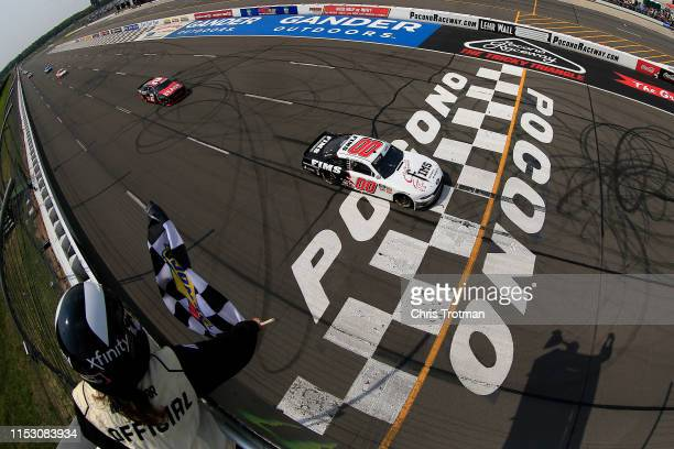 Cole Custer driver of the FIMS Manufacturing Ford crosses the finish line to win the NASCAR Xfinity Series Pocono Green 250 at Pocono Raceway on June...