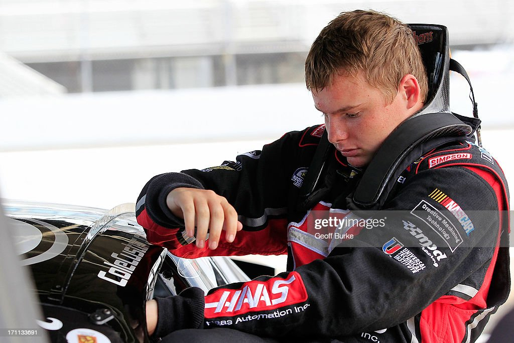 Cole Custer, driver of the #00 Haas Automation Chevrolet, climbs from his car during practice for the NASCAR K&N Pro Series East Visit Hampton VA 175 at Langley Speedway on June 22, 2013 in Langley, Virginia.