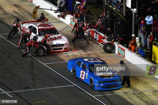 Cole Custer driver of the Haas Automation Ford and John Jackson driver of the OCR Gaz Bar Dodge pit during the NASCAR XFINITY Series O'Reilly Auto...