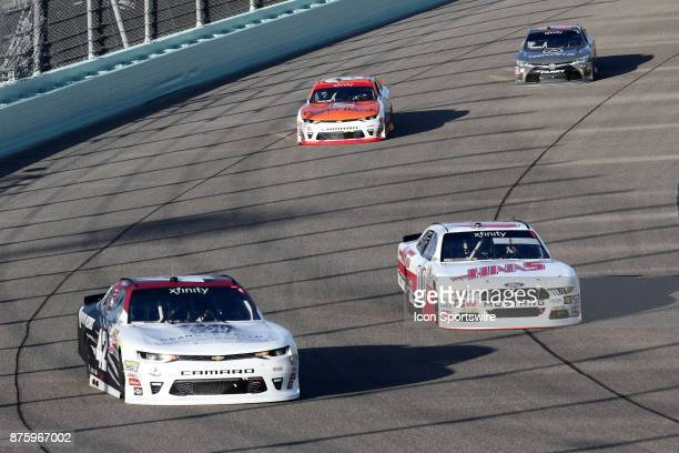 Cole Custer driver of the Haas Automation Ford and Tyler Reddick driver of the BBR/Granger Smith Chevy in turn 1 during the EcoBoost 300 at...