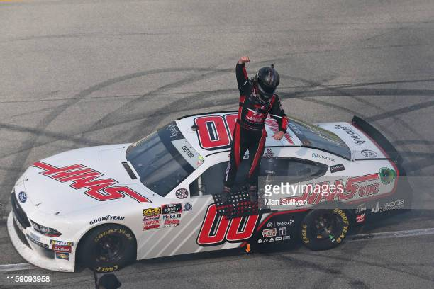 Cole Custer driver of the Haas Automation Ford celebrates after winning the NASCAR Xfinity Series Camping World 300 at Chicagoland Speedway on June...