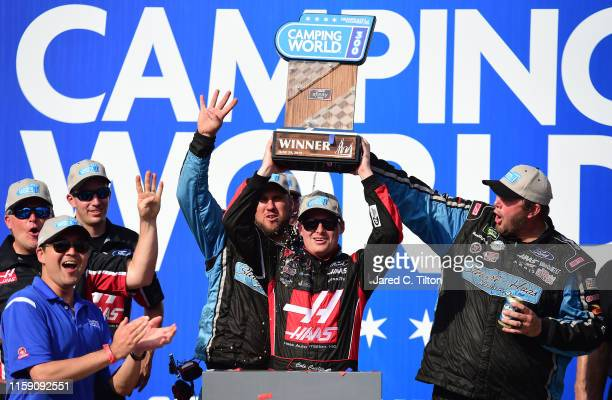 Cole Custer driver of the Haas Automation Ford celebrates in Victory Lane after winning the NASCAR Xfinity Series Camping World 300 at Chicagoland...
