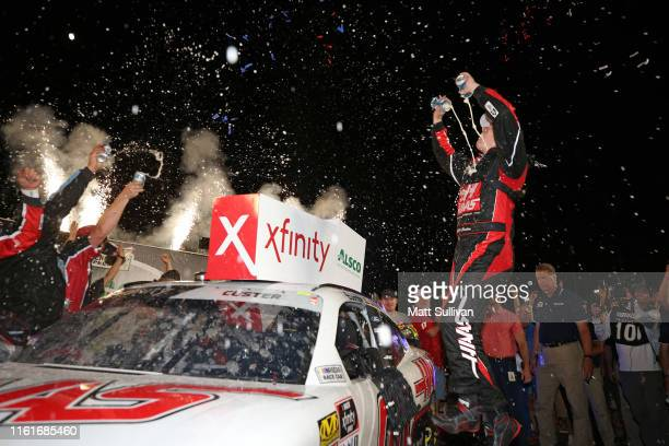 Cole Custer driver of the Haas Automation Ford celebrates in Victory Lane after winning the NASCAR Xfinity Series Alsco 300 at Kentucky Speedway on...